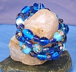 Click here to enlarge image and see more about item BRGL009: Shades of Aqua Blue Lampwork Glass Wrap