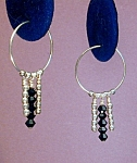 Click here to enlarge image and see more about item ERSW001J: Swarovski Jet & SS Hoop earrings