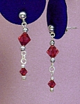Click here to enlarge image and see more about item ERSW009G: Swarovski Garnet & SS Drop Earrings