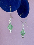 Click here to enlarge image and see more about item ERSW011P: Swarovski Peridot Bicone & SS earrings