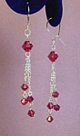 Click here to enlarge image and see more about item ERSW014G: Swarovski Garnet & SS Figaro Chain earrings