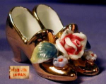 Click here to enlarge image and see more about item JPN009: Miniature gold shoes with rose