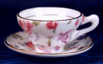 Click here to enlarge image and see more about item MINI012: Rosina pink chintz miniature cup & saucer