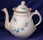 White teapot with green transfer leaves