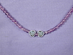 Click here to enlarge image and see more about item NKA001: Amethyst & Celtic Hearts necklace