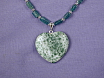 Click here to enlarge image and see more about item NKGM001: Green Adventurine w/Tree Agate Heart Pendant