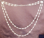 Click here to enlarge image and see more about item NKPRL001: White Freshwater Pearl Nugget Double Strand