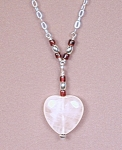 Click here to enlarge image and see more about item NKRQG001: SS & Garnet Necklace w/Rose Quartz Heart