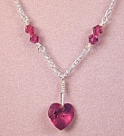 Click here to enlarge image and see more about item NKSW012G: Swarovski Garnet Heart & SS Necklace