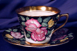 Click here to enlarge image and see more about item ROS017: Rosina Pink/Yellow Roses on black w/gold c&s