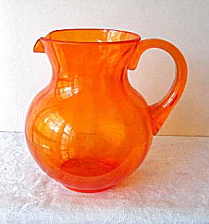 1990 Orange Clear Plastic Unusual Pitcher  (Image1)