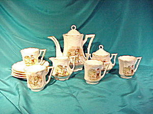 GERMAN CHILD'S TEA SET W/GIRL & BOY & SWANS (Image1)