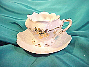 RS PRUSSIA(?) WHITE/GOLD 8 FOOTED CUP/SAUCER (Image1)