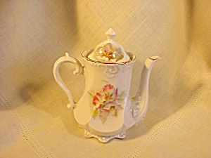 GERMAN CHILD'S ORNATE TEA POT (Image1)