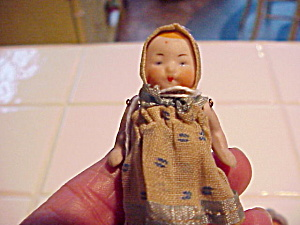 ANTIQUE BISQUE BABY DOLL W/ORIG. CLOTHES (Image1)