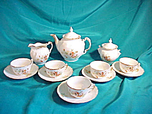 RS PRUSSIA(UM)17PIECE CHILD'S TEA SET(POPPIES (Image1)
