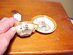 JAPANESE CHILD MISS MUFFET CUP/SAUCER (Image1)