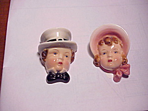 GOLDSCHEIDER BOY AND GIRL WALL PLAQUES (Image1)