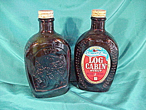 LOG CABIN COLLECTORS' FLASKS (2)W/EMBOSSD PIX (Image1)