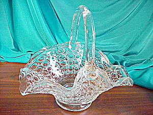 PRESSED GLASS HANDLED BASKET W/IMPR. CIRCLES (Image1)