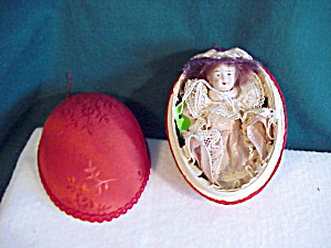 GERMAN BISQUE DOLL INSIDE OF RIBBON EGG (Image1)