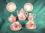 Click here to enlarge image and see more about item c352: UNMARKED 11 PIECE CHILD'S TEA SET W/FLOWERS