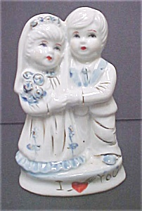 Young Girl & Boy Ceramic Figures (Image1)