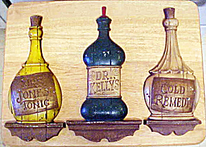 Sexton Three Metal Bottle Wall Plaques (Image1)