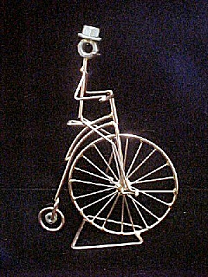 Wire Artwork - Man on Columbia High-Wheeler (Image1)