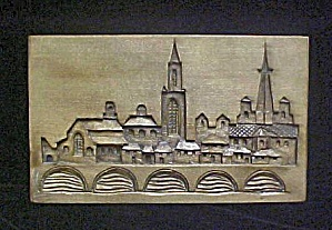 Wood Carved Picture Of A City Skyline