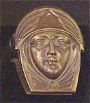 Click here to enlarge image and see more about item A101: Bronze Letter Clip- Figural Face