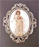 Click here to enlarge image and see more about item A468: Oval Portrait Pin/Pendant  -Silver Tone Frame