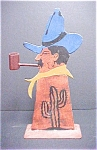 Click here to enlarge image and see more about item A475: Iron Cut Out of Cowboy With Pipe