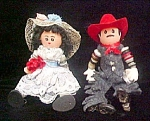 Click here to enlarge image and see more about item A707: Wood/Button Western Couple - Dolls