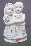 Click here to enlarge image and see more about item A722: Young Girl & Boy Ceramic Figures