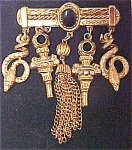 Click here to enlarge image and see more about item A731: Unusual Gold Toned Brooch