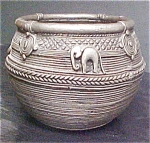 Click here to enlarge image and see more about item A883: Textured Metal Pot from Nepal