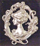 Click here to enlarge image and see more about item A93: Art Nouveau Style Figural Pin