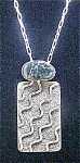 Click here to enlarge image and see more about item AA300: Navajo Petrograph Pendant - Signed