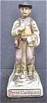 Click to view larger image of Bisque Porcelain Western Businessman (Image1)