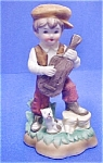 Click here to enlarge image and see more about item AA373: Vintage Ceramic Boy w/Banjo