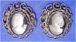 White Cameo Clip-Back Earrings on Black Stone