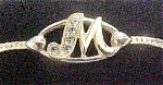 Click to view larger image of Avon Gold-Toned M Initial Metal Bracelet (Image1)