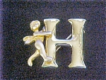 Click here to enlarge image and see more about item AA410: Gold-Toned Cherub w/H Letter Pin