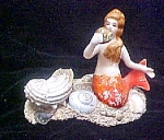 Click here to enlarge image and see more about item AA506: Vintage Ceramic Mermaid w/Shells