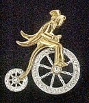 Click here to enlarge image and see more about item AA695: Figural Pin - Gentleman Riding High Wheeler