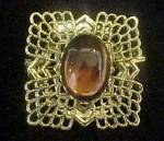 Click here to enlarge image and see more about item AA831: Jeweled Gold-Tone Clip w/Cabochon