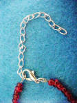 Click to view larger image of Faceted Cherry-Red Plastic Bead Necklace (Image4)