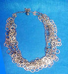 Click to view larger image of Kramer Multi-Rings Metal Necklace (Image1)
