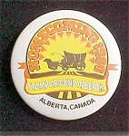 Click here to enlarge image and see more about item P108: Stamp Around Alberta Advertising Pin Back